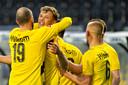Sydney van Hooijdonk wordt gefeliciteerd na zijn rake vrije trap, de 3-1 voor NAC tegen Jong FC Utrecht.