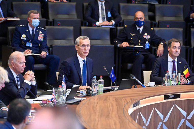 Van links naar rechts: Joe Biden, Jens Stoltenberg en Alexander De Croo. Beeld BELGA