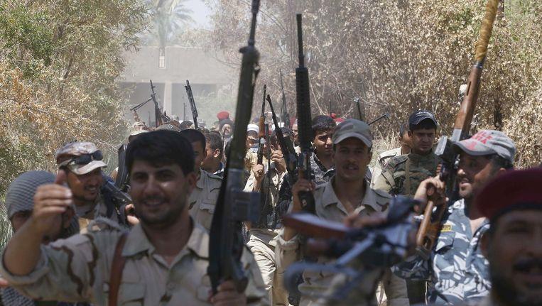 Iraakse soldaten van de Abbas-eenheid in Jurf al Sakhr, 60 kilometer van Bagdad. (archiefbeeld) Beeld afp