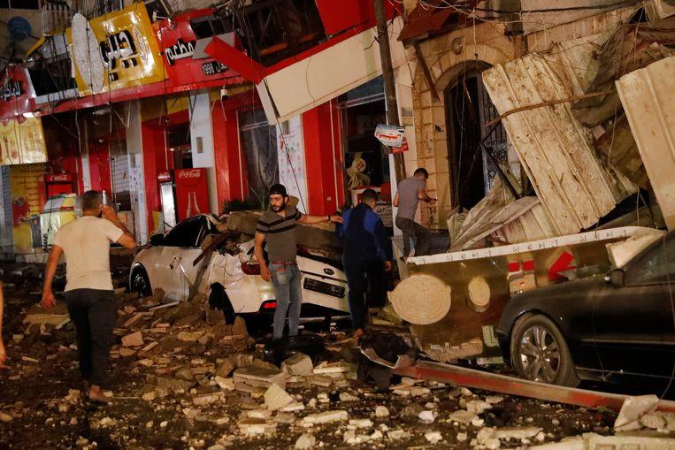 Verwoeste gebouwen in de Gazastrook. Beeld AP