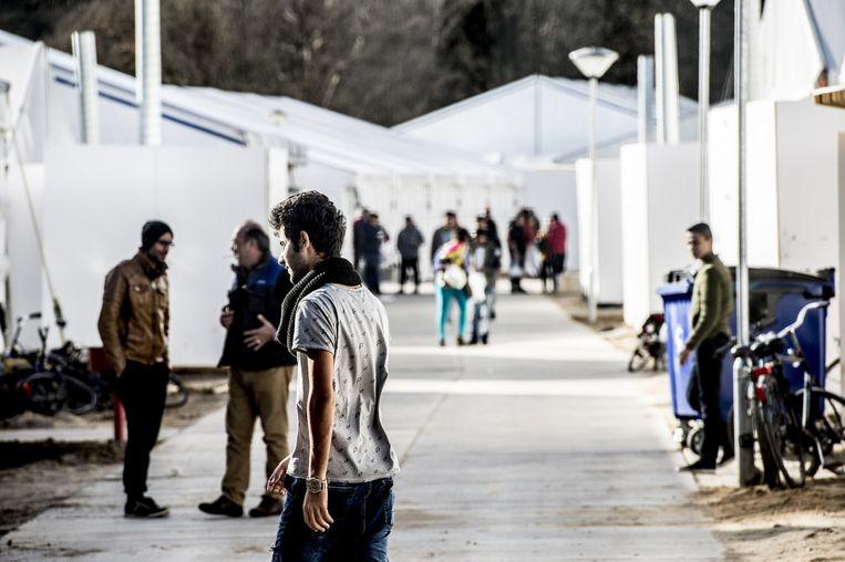 Vluchtelingen in Heumensoord, het tentenkamp dat werd opgezet bij Nijmegen voor de opvang van asielzoekers.  Beeld anp
