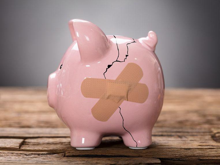 broken-pink-piggybank-with-bandage.jpg