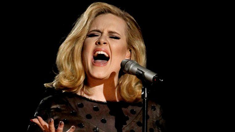 Adele tijdens een optreden in 2012. Beeld AP