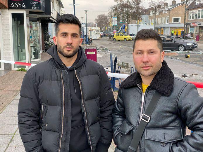 Broers Mohamad (l) en Moshkhal (r) Mahmoed zijn voor hun zwaar beschadigde winkel in Aalsmeer. Ook hun winkel in Beverwijk is nu doelwit van een explosie.