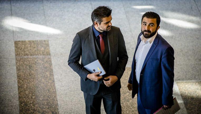 Tunahan Kuzu en Selcuk Ozturk van DENK in de Tweede Kamer, 12 september. Beeld anp