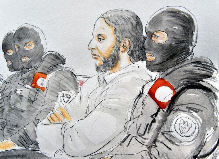 Een schets van Salah Abdeslam tijdens de eerste dag van het proces. Beeld REUTERS