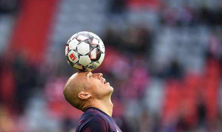 Arjen Robben warmt zich op voor de wedstrijd tegen SC Freiburg op 3 november 2018. Beeld AFP
