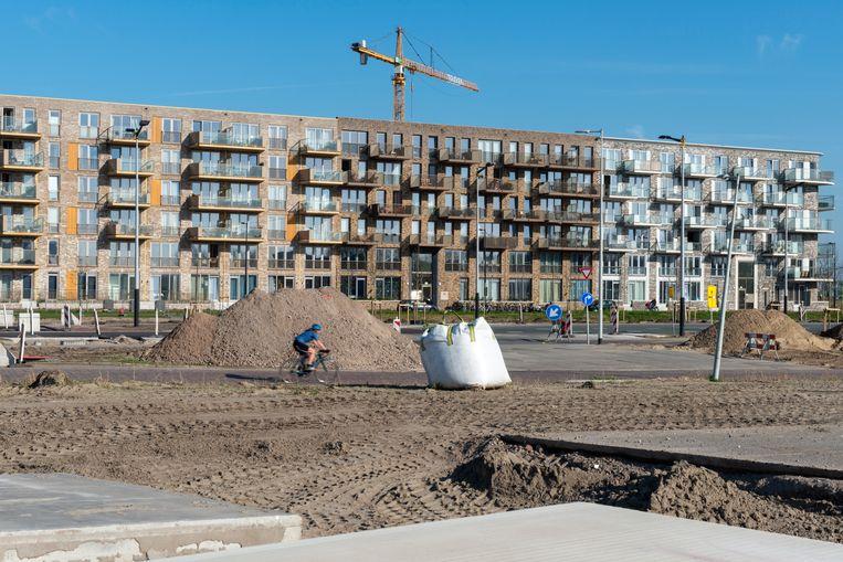Nieuwbouw, zoals hier op Zeeburgereiland, draagt bij aan een stabielere woningmarkt.  Beeld Hollandse Hoogte