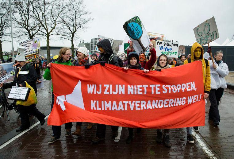 Demonstranten op het Museumplein tijdens een klimaatmars. Beeld ANP