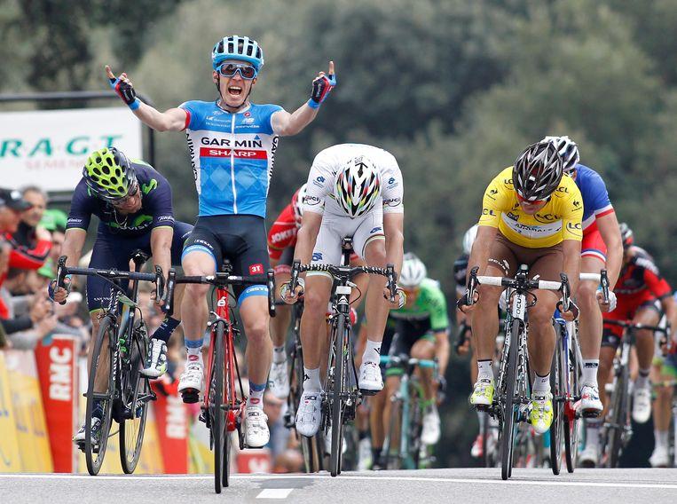 Slagter viert zijn overwinning in een etappe van Parijs-Nice in 2014.  Beeld Hollandse Hoogte / EPA