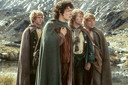 Dominic Monaghan als Merry, Elijah Wood als Frodo, Billy Boyd als Pippin en Sean Astin als Sam Gewissie in een scene uit 'The Lord of the Rings: Fellowship of the Ring'.