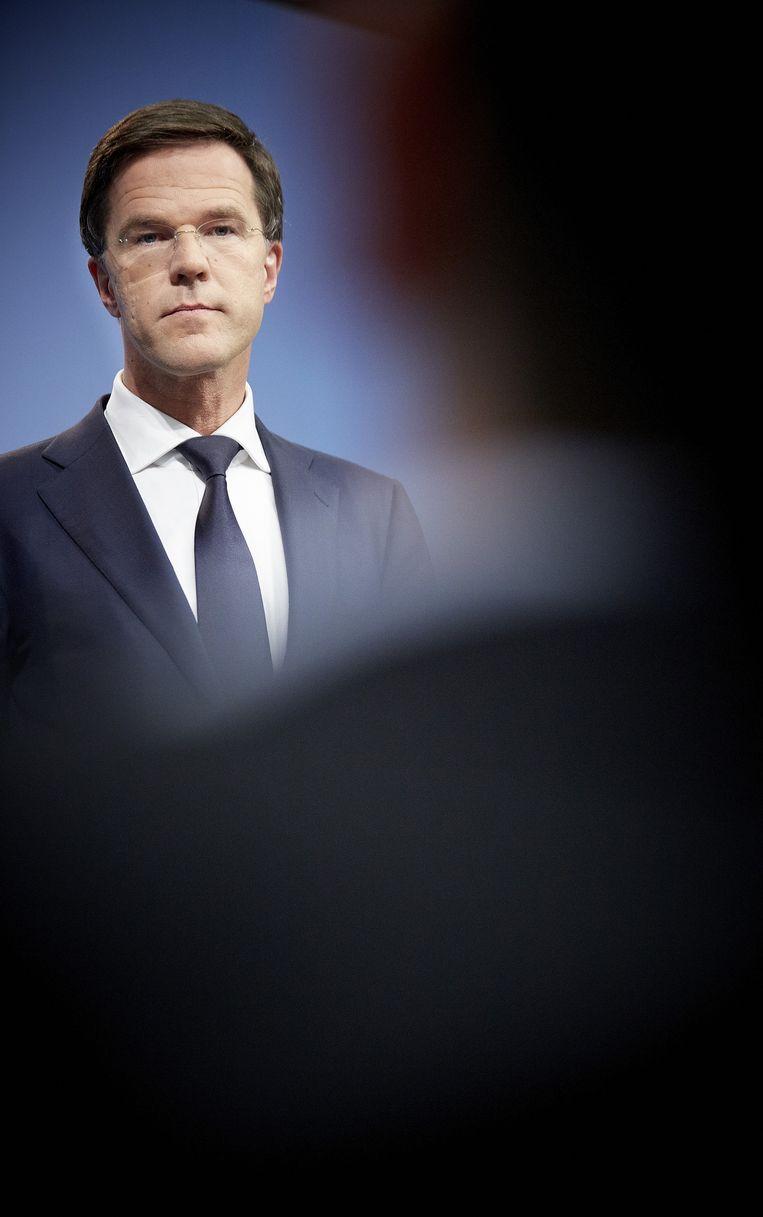 Premier Rutte tijdens een persconferentie in Nieuwspoort. Beeld ANP