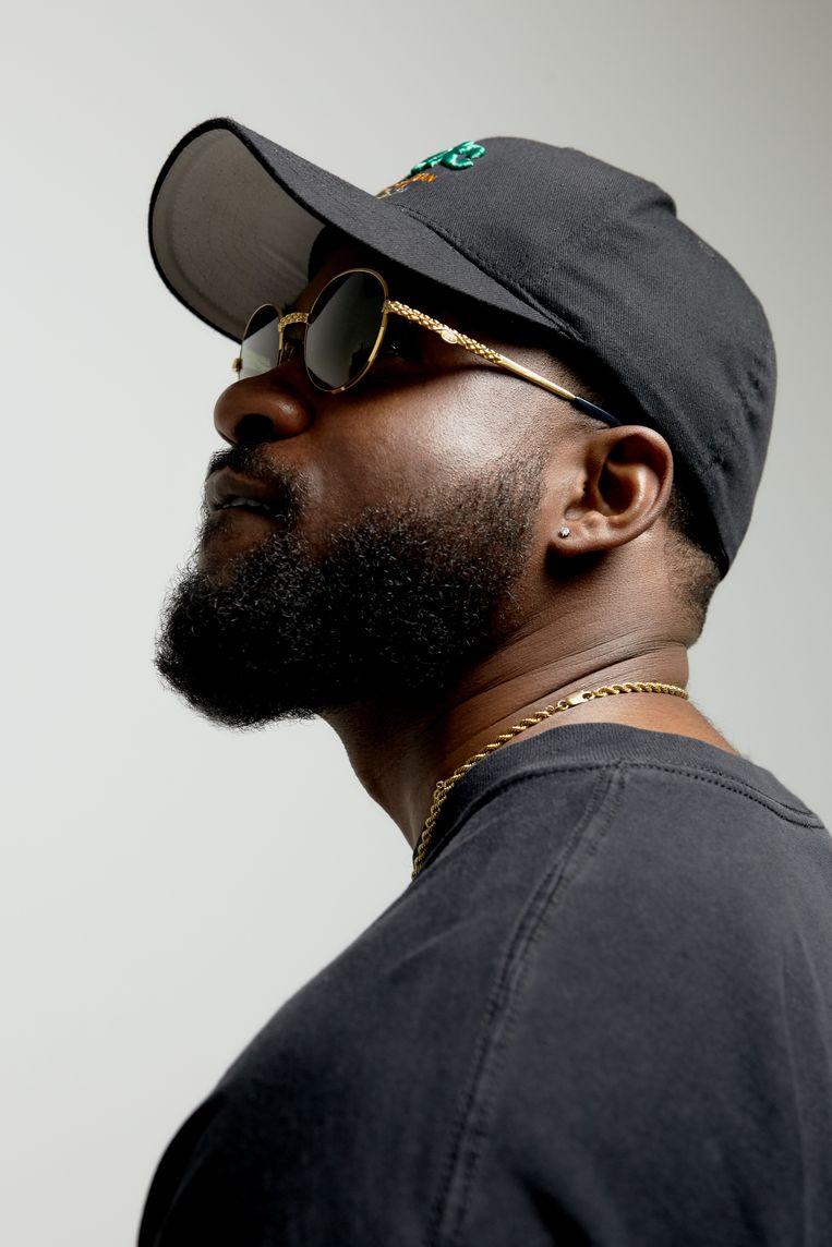 Rapper Cho: 'Voor sommige mensen ben ik een gevestigde naam, maar ik zie mezelf nog steeds als timmerend aan de weg.'  Beeld Kwabena Appiah-nti