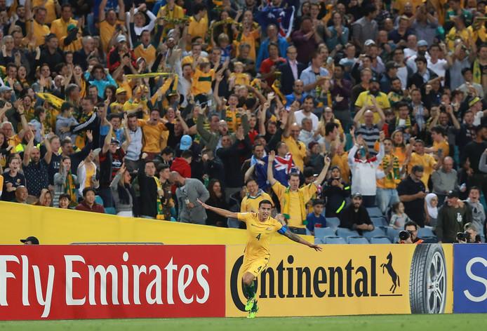 Fans van Australië juichen na de goal van Tim Cahill, waarmee kwalificatie voor het WK 2018 wed veiliggesteld.