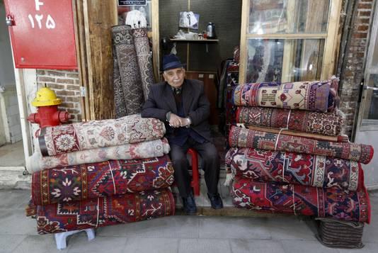 Een tapijthandelaar in Iran.