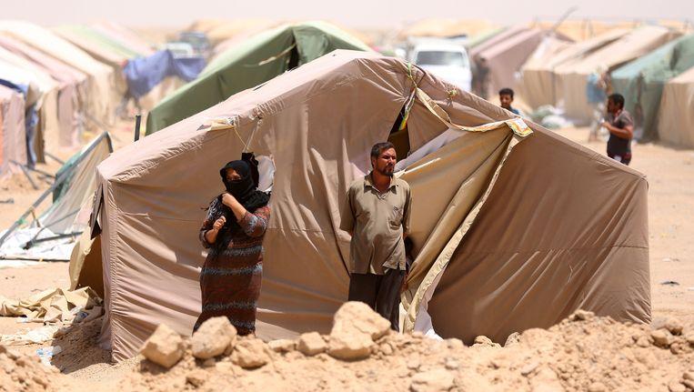 Vluchtelingen uit Ramadi in een tentenkamp ten westen van Bagdad. Beeld ap