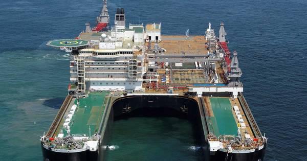 Grootste schip van de wereld koerst naar rotterdam rotterdam - Spiegelhuis van de wereld ...