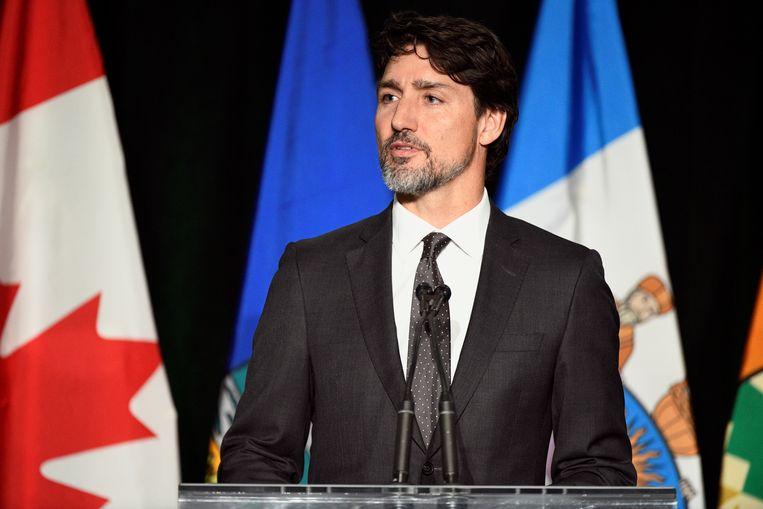 De Canadese premier Justin Trudeau sprak op 12 januari bij een herdenkingsdienst in het Canadese Edmonton voor de slachtoffers van de vliegramp in Iran. Beeld REUTERS