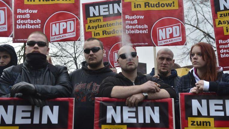 Aanhangers van de extreem rechtse partij NPD. Beeld afp