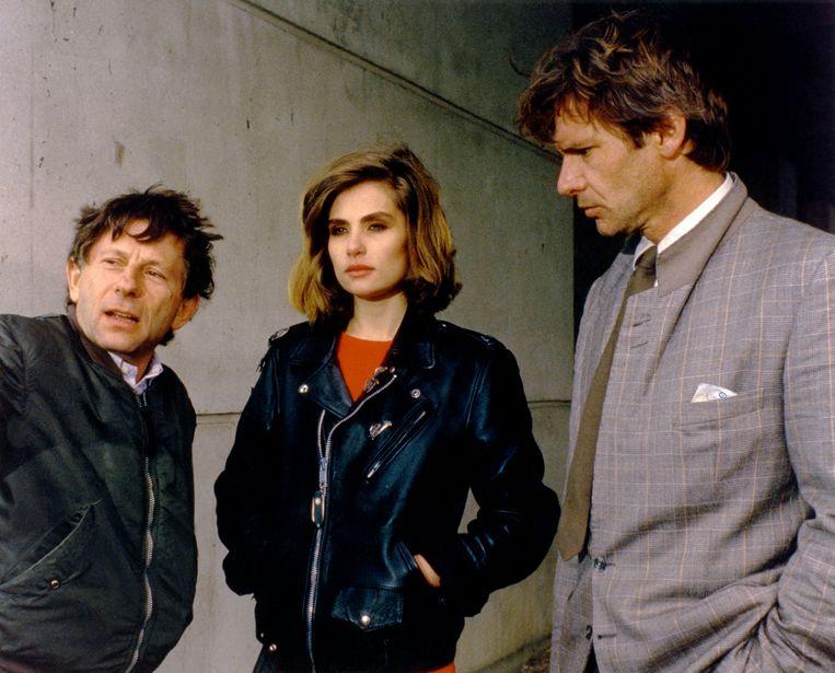 Roman Polanski, Emmanuelle Seigner en Harrison Ford op de set van Frantic. Beeld Getty