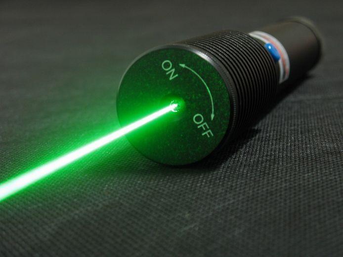 Ter illustratie een laserpen.