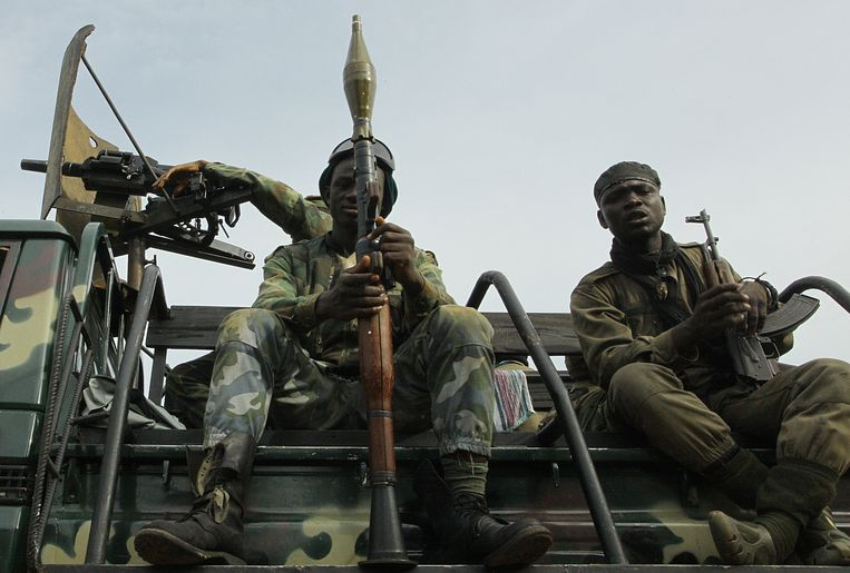 Pro-Ouattara fighters of the FRCI (Republican Force of Ivory Coast), one of them with a RPG grenade launcher, prepare for the so-called