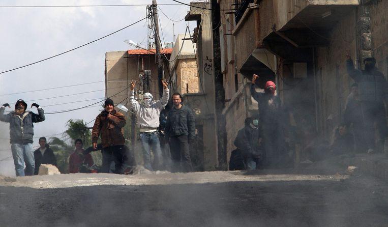 2011: tegenstanders van het regime van Assad gingen in Daraa de straat op. Toen leek het er niet op dat tien jaar later Assad nog steeds aan de macht zou zijn. Beeld AFP