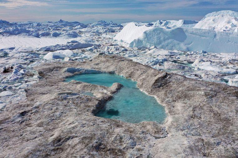 Smeltend ijs vormt een meer in de IJsfjord van Ilulissat, Groenland.  Beeld Getty Images