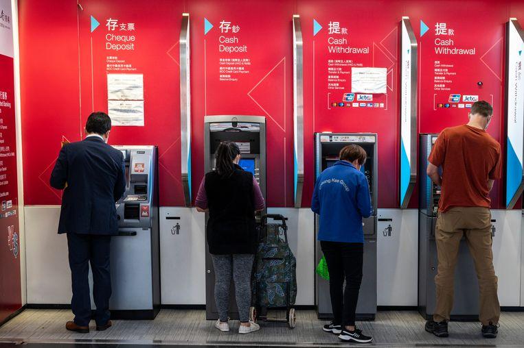Pinautomaten in Hongkong. Beeld Getty