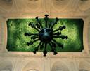 """En 2002, la reine Paola a demandé à l'artiste Jan Fabre de réaliser dans la Salle des Glaces une œuvre d'art, baptisée """"Heaven of Delight"""" ou """"Le jardin des Plaisirs."""" C'est ainsi que près d'un million et demi d'élytres de scarabées ont recouvert le plafond et le lustre central."""