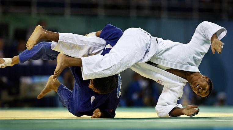 Einde toernooi voor Dex Elmont (witte pak) in de tweede ronde; hij verliest van de Amerikaan Taylor Takata. Foto ANP/Robert Vos Beeld