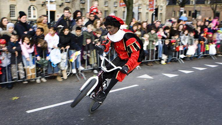 Zwarte Piet tijdens een eerdere intocht in Amsterdam. Beeld anp