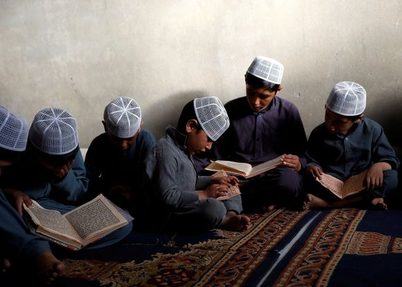 Afghan boys read the Koran in a madrasa, or religious school, during the Muslim holy month of Ramadan in Kabul, Afghanistan May 28, 2018. REUTERS/Mohammad Ismail