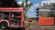 Isolatie nieuwbouwappartementen vat vuur tijdens asfalteringswerken