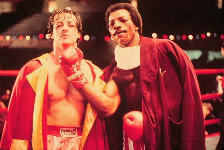 Sylvester Stallone en Carl Weathers in Rocky. Beeld ANP