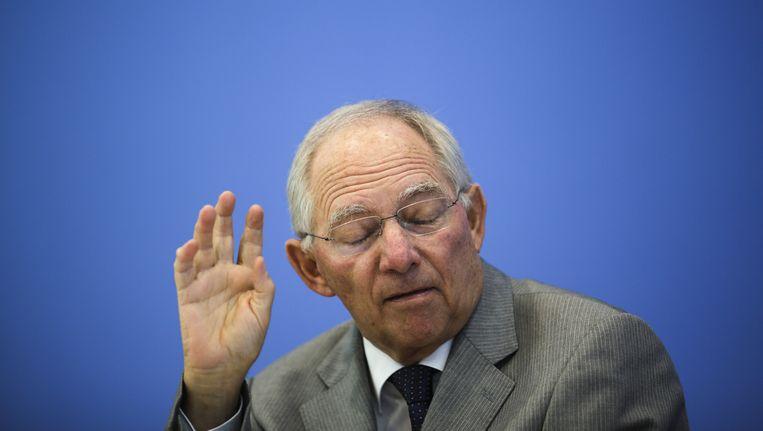 Duits minister van Financiën Wolfgang Schäuble ziet weinig lichtpunten in de brief van Tsipras. Beeld AP