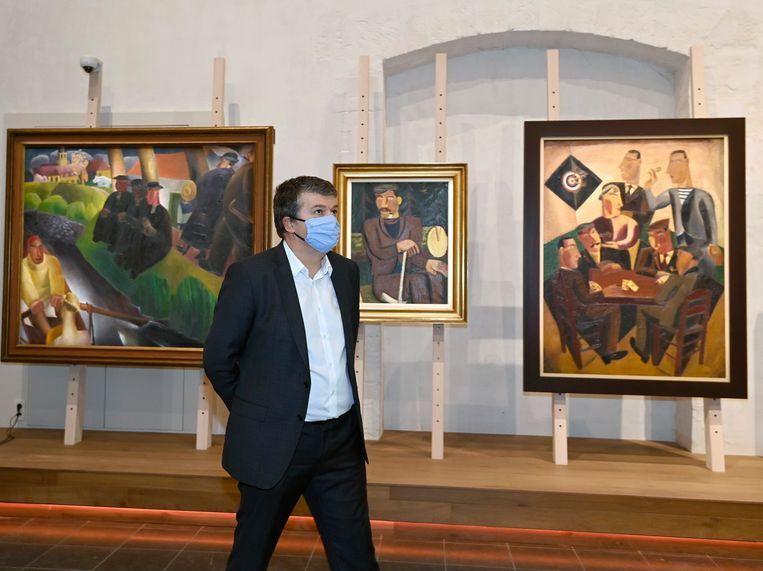 Vlaam minister Bart Somers bij de opening van de expo. Beeld Photo News