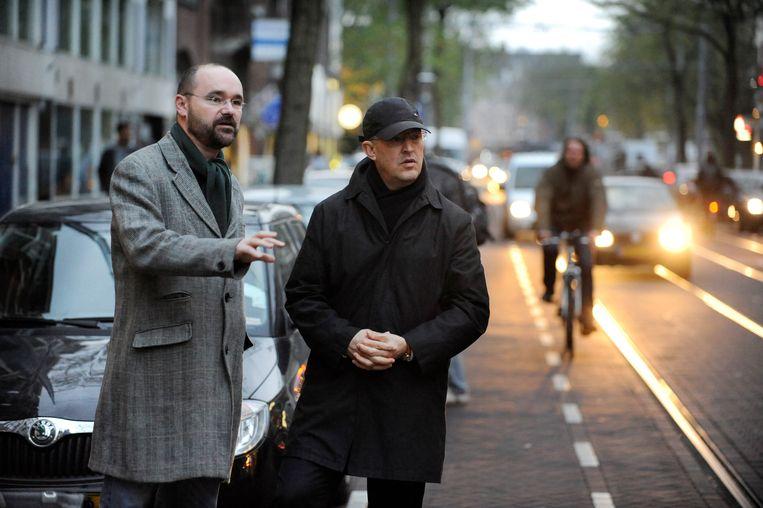 Burgemeester Ahmed Aboutaleb,  burgemeester van Rotterdam met de stadsmarinier Marcel Dela Haije. Beeld Belga