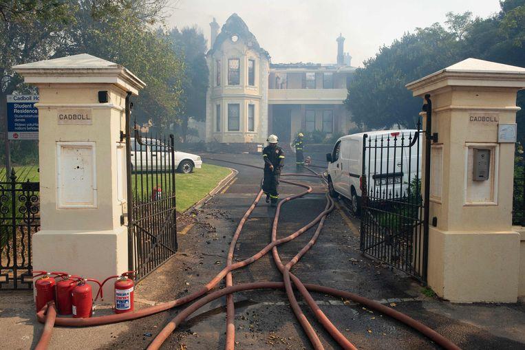 Een uitgebrande studentenwoning. Beeld AFP