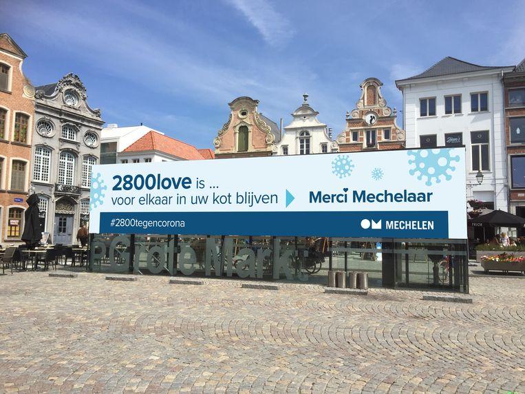 Deze banner op de Grote Markt wordt vervangen door een antiracismeboodschap.  Beeld Stad Mechelen