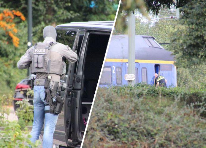 De politie maakt zich op zondagmiddag klaar voor een actie richting de stilstaande trein op station Apeldoorn.