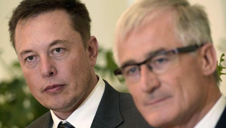 Tesla-topman Elon Musk (links) en Vlaams minister-president Geert Bourgeois. Beeld PHOTO_NEWS