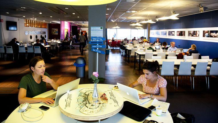Zzp'ers aan het werk in een Seats2meet in Utrecht. Beeld ANP