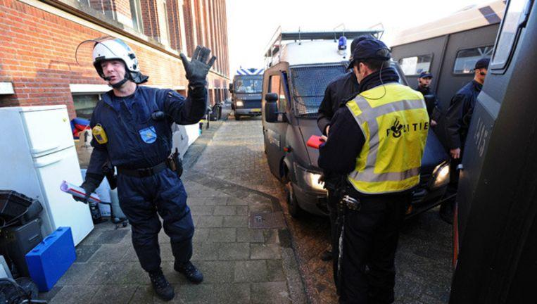 Vorige week ontruimden ME en politie het Shell-gebouw in Amsterdam-Noord. © ANP Beeld
