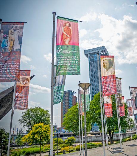 Nederlands-Indische Rotterdammers herdenken oorlog door familiefoto's op vlaggen