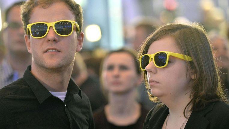 Aanhangers van de FDP horen de verkiezingsuitslagen. Beeld ap