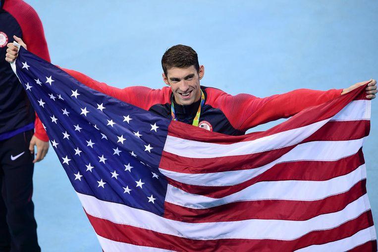 Michael Phelps is blij met zijn laatste overwinning. Beeld photo_news