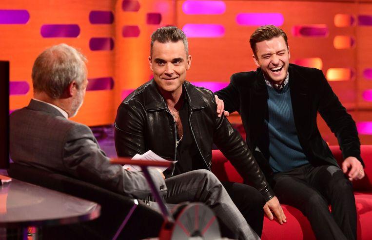 Graham Norton met Robbie Williams en Justin Timberlake. Beeld Photo News