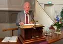 Dominee Jan Mudde uit Haarlem op de kansel van de Wilhelminakerk, vlak voordat hij zijn rap inzet.
