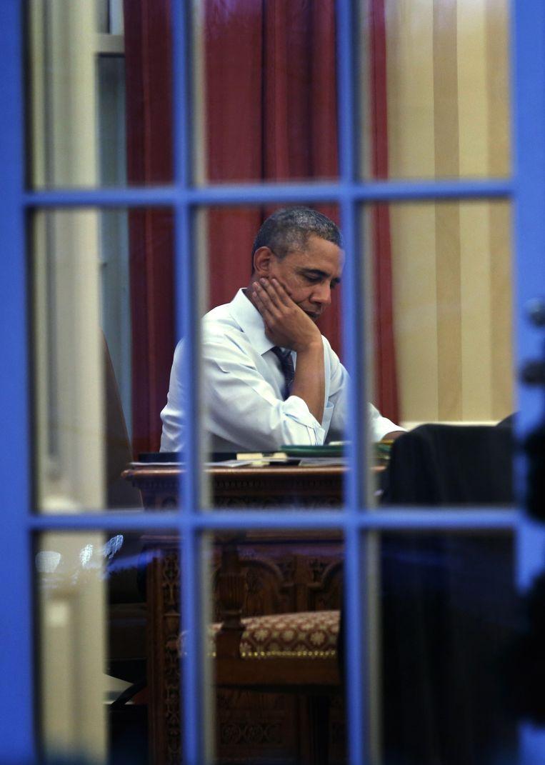 Obama werkt aan zijn speech voor de State of the Union, een moment vergelijkbaar met de Troonrede. Beeld Getty Images